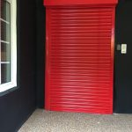 Roller shutter powder coated in red